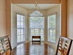 Enjoy meals at the 4-person dining table surrounded by windows.