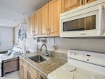 Easily prepare a fresh fruit salad in this well-equipped kitchenette.
