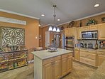 The spacious, fully equipped kitchen provides everything you'll need to whip up gourmet recipes.