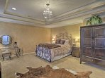 The master bedroom boasts a plush queen bed, flat-screen TV and pristine en-suite bath.