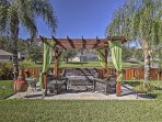 A lush backyard with outdoor furnishings and beautiful views awaits 6 lucky guests.