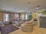 The home includes a second living area complete with a flat-screen Smart TV and mini-fridge.