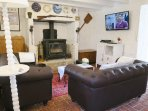 the lounge with wood burner TV & wifi