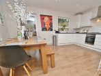 Huge dining table seats ten in fully equipped kitchen.