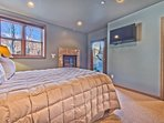 Level 1 - 2nd Master Bedroom with Queen Bed, Radiant Heat, a Gas Fireplace, TV, Private Bath and Backyard Access