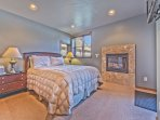Level 1 - 2nd Master Bedroom with a Queen Bed, Radiant Heat, a Gas Fireplace, Private Bath and Backyard Access