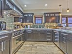 Fully Equipped Kitchen with Stainless Steel Appliances including a 4-Burner Gas Range