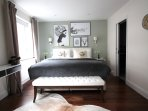 Master bedroom with king size bed.