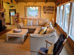 Upper level living area with cable TV/DVD player, wood burning fireplace, ocean views and a door leading to west facing...