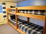 Lower level bedroom with two custom built bunk beds