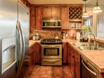 Beautiful kitchen equipped with high end appliances and cooking essentials