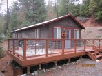 Front of cabin. Deck is kid proof with hog wire railing.