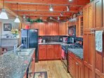 The kitchen is fully equipped with updated appliances and ample granite counter space.