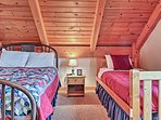 Climb under the covers of the full-sized and twin-sized beds in the third bedroom.