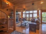 2,800 square feet of rustic living space, wood paneling, and natural light await!