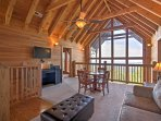 Journey upstairs to this cozy den, highlighted by cathedral ceilings.