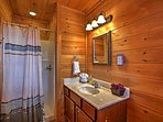 Both upstairs bedrooms offer identical full baths with walk-in showers.
