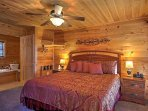 The main level's master bedroom offers a plush king bed to cuddle up in.