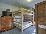 This bedroom offers a twin-over-twin bunk bed and a full-over-full bunk bed - great for kids.
