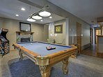 The rec room offers endless fun with amenities like this pool table.