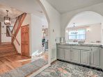 The kitchen's unique archways add a fun architectural flair to the space.