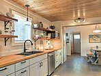 Beautiful cedar counters and ceilings highlight the kitchen.
