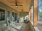 Settle down in the screened-in porch while you enjoy wilderness views outside.