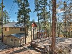 'Cabin in the Sky' is nestled in a quiet wilderness near shops and restaurants.