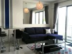 This is the living area which comes with high quality L sofa bar top table and coffee table