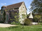 The Barn from the large orchard garden in springtime the lovely wisteria in full bloom