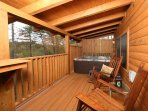 Spacious Back Deck with Rocking Chairs and Hot Tub