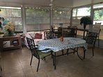 Lanai with table and chairs and hot tub