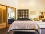 very comfortable queen size bed, build in literary, large arm chair perfect for reading