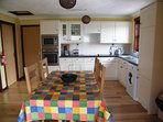 Kitchen with full size oven, hob fridge, washing machine and freezer