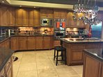 Large Gourmet Kitchen with several prep stations.