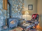 The 1,300-square-foot interior is filled with beautiful decorations like this river rock wall.