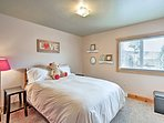 The master bedroom offers a cozy queen bed.