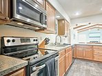 The stainless steel appliances make cooking a breeze in this state of the art kitchen.