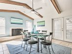 Turn on the  fireplace and gather for dinner under the dining room's vaulted ceilings with exposed beams.