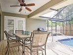 Take in the fresh air as you enjoy a family dinner at the lanai's dining table.