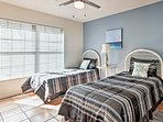 This bedroom, featuring 2 plush twin beds, is perfect for siblings or friends!