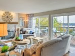 Sliding glass doors open onto the deck and offer a view of the lake.