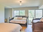 This room features 2 twin beds and 1 full-sized bed.