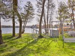 The property sits directly on Lake Mary, offering a private dock and boats available to rent.