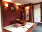 Downstiars private couple's retreat with tatami mat flooring.