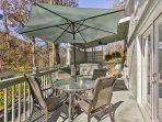 Step outside and dine al fresco underneath the shade umbrella.