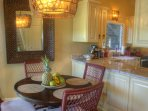 Dinning room opens to the kitchen . Coconut mirror . Polynesian lamp
