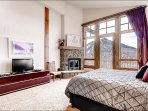 Master Bedroom with Fireplace and Amazing View from the Deck