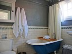 A lovely bathroom with claw foot bathtub and shower