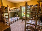Main level bedroom with 2 sets of twin bunks